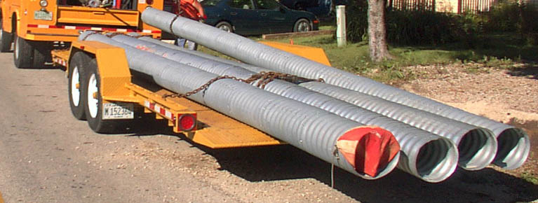 Truck hauling pipes