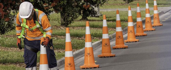 Road District worker putting down street cones